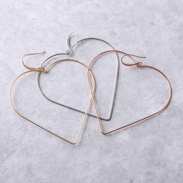 """Metal heart drop earrings. Approximately 3"""" in length."""