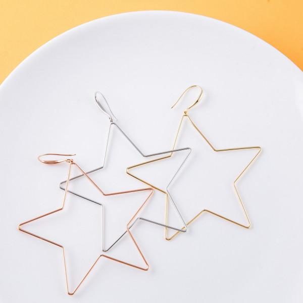 "Metal star drop earrings. Approximately 3"" in length."