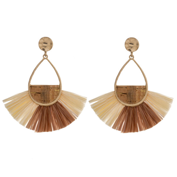 "Long metal teardrop earrings featuring raffia tassel details with a cork inspired center accent. Approximately 3"" in length."