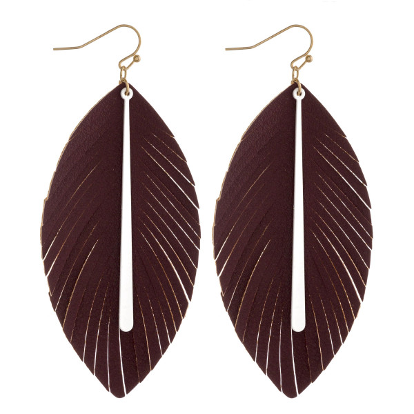 """Game day faux leather feather inspired earrings featuring a colored bar accent. Approximately 3.5"""" in length."""