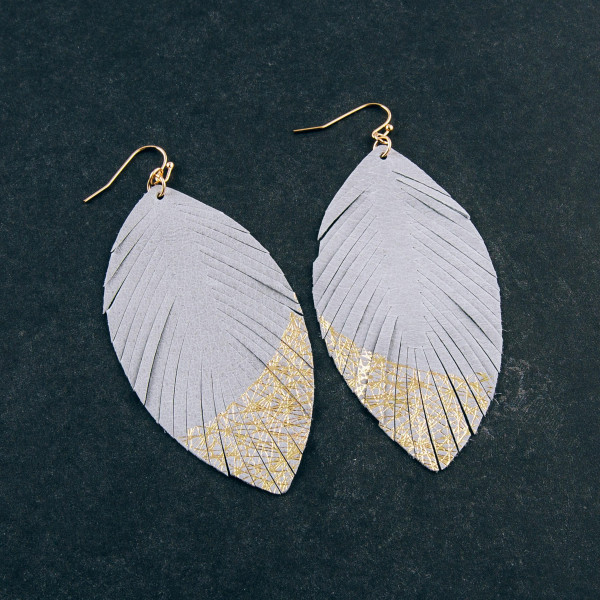 """Long faux leather feather inspired earrings featuring metallic details. Approximately 3.5"""" in length."""