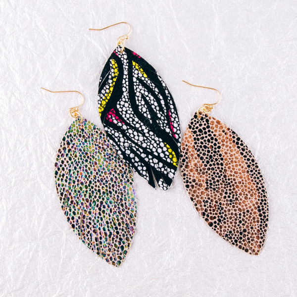 """Faux leather feather earrings featuring animal print details. Approximately 3.5"""" in length."""