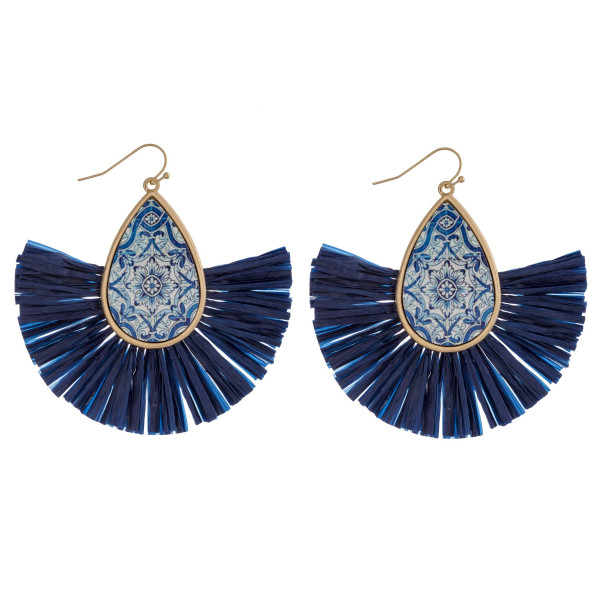 """Teardrop earrings featuring raffia tassel details with a wood inspired pattern accent. Approximately 3"""" in length."""