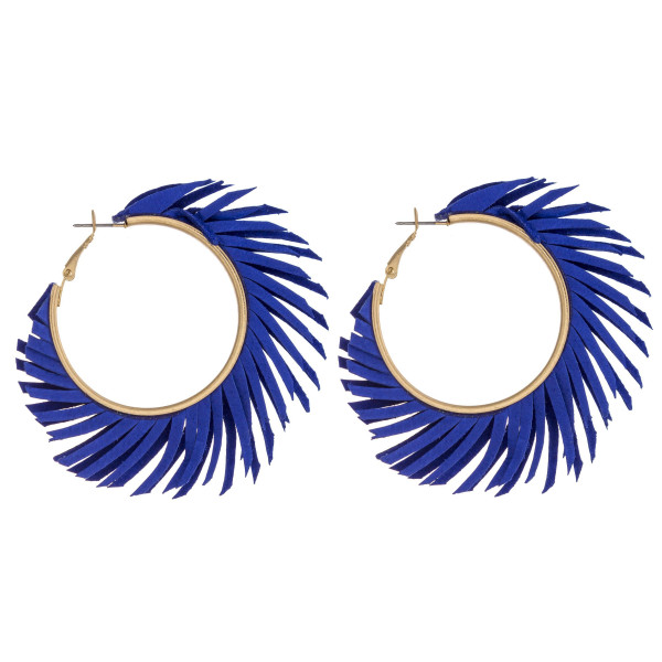 "Large hoop earrings featuring feather inspired tassel accents. Approximately 2"" in diameter."