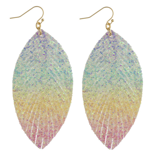 "Fabric inspired feather earrings featuring rainbow details with glitter accents. Approximately 3.5"" in length."