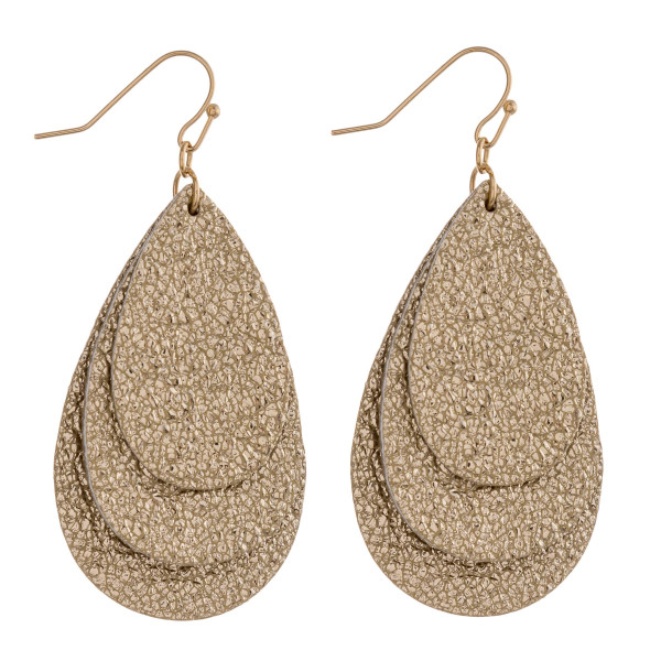 "Trio layered metallic faux leather teardrop earrings. Approximately 2.5"" in length."
