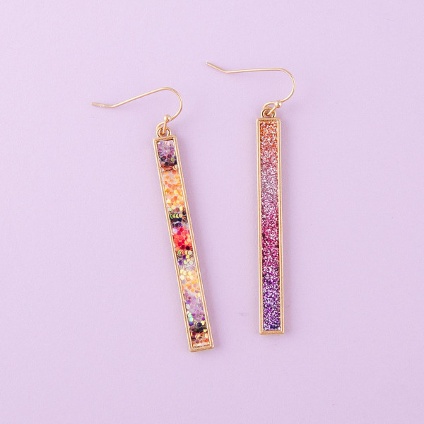 "Metal bar earrings with multicolor glitter details. Approximately 2.5"" in length."