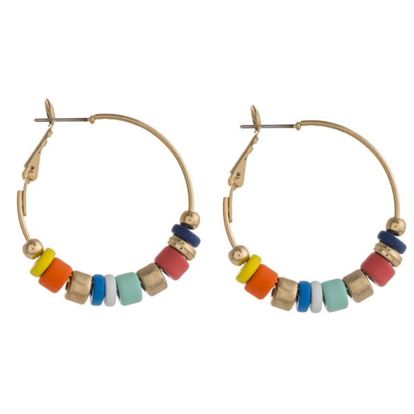 "Gold hoop earrings featuring color-block bead details. Approximately 1.5"" in diameter."
