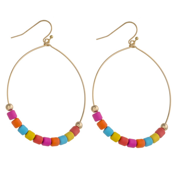 "Gold teardrop earrings featuring color-block bead details. Approximately 2.5"" in length."