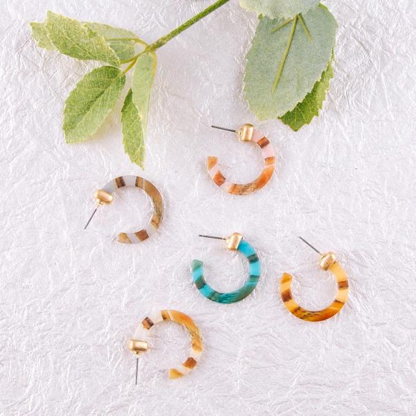 """Matte resin hoop earrings. Approximately 1"""" in diameter."""