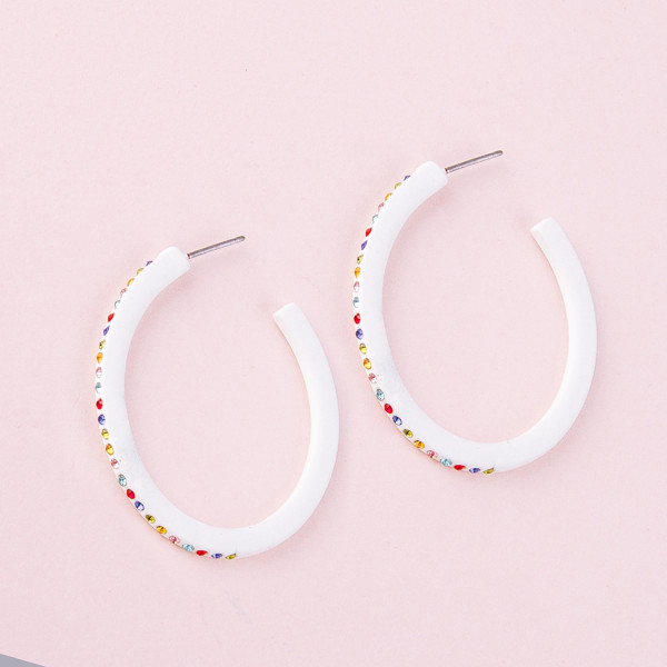 "White hoop earrings with multicolor cubic zirconia details. Approximately 1.5"" in diameter."