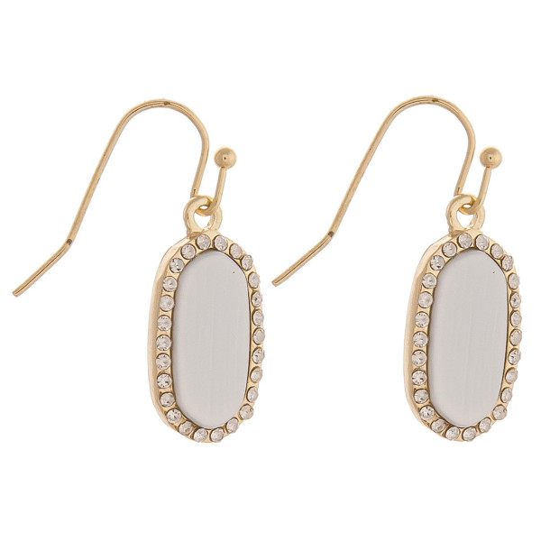 "Dainty metal drop earrings featuring a resin inspired center accent with cubic zirconia details. Approximately .75"" in length."