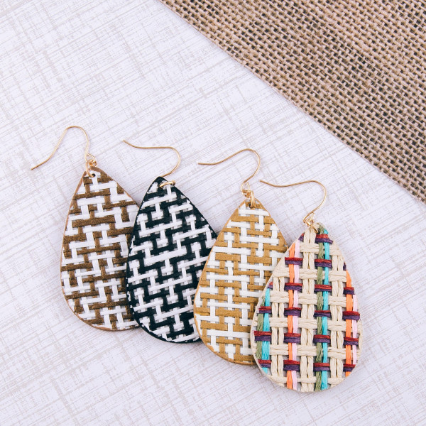 "Faux leather rattan woven teardrop earrings. Approximately 2"" in length."
