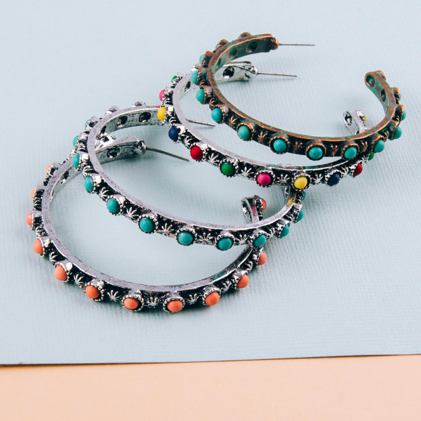 "Western style hoop earrings with natural stone accents. Approximately 2"" in diameter."