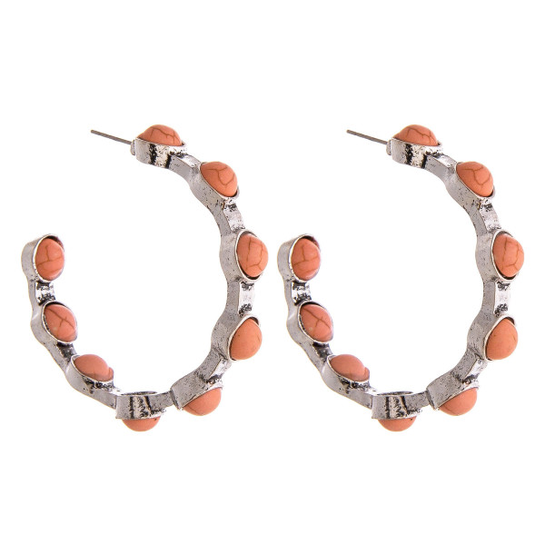 """Metal hoop earrings featuring natural stone inspired details and a stud post. Approximately 2"""" in diameter."""