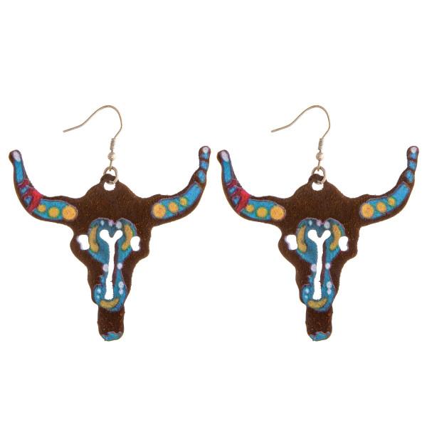 "Metal cow skull earrings. Approximately 2.5"" in length."