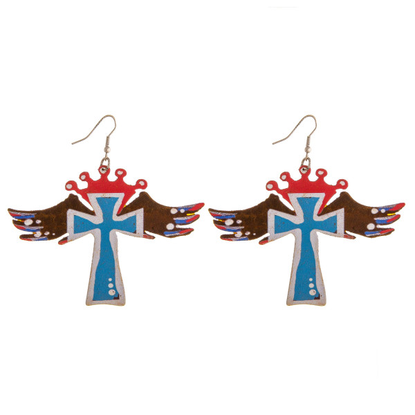 "Metal cross earrings featuring wings and crown details. Approximately 3"" in length."