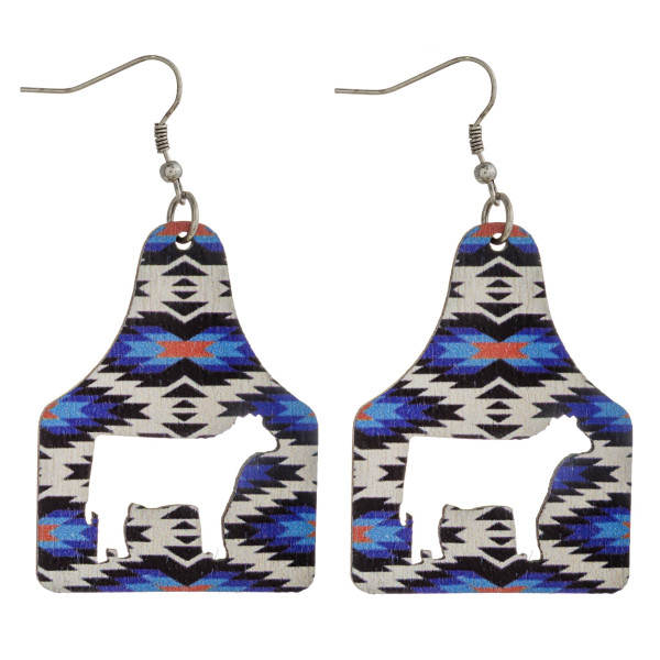 """Wood inspired cut out cow tag earrings featuring western pattern details. Approximately 2.5"""" in length."""
