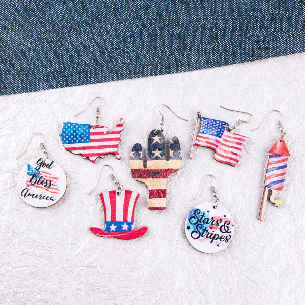 """Wood inspired disc earrings featuring """"Stars and Stripes"""" airbrushed details. Approximately 1.5"""" in length."""