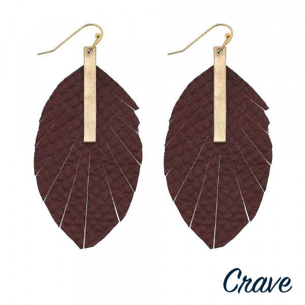"""Faux leather feather inspired earrings featuring snakeskin details and a gold bar accent. Approximately 3"""" in length."""