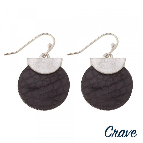"""Faux leather disc earrings featuring snakeskin details with a silver metal accent. Approximately 1"""" in length."""