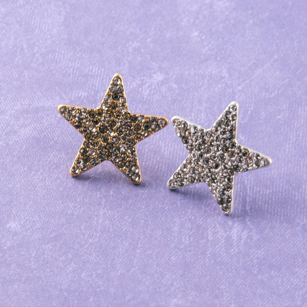 """Metal star stud earrings featuring cubic zirconia details. Approximately .5"""" in length."""