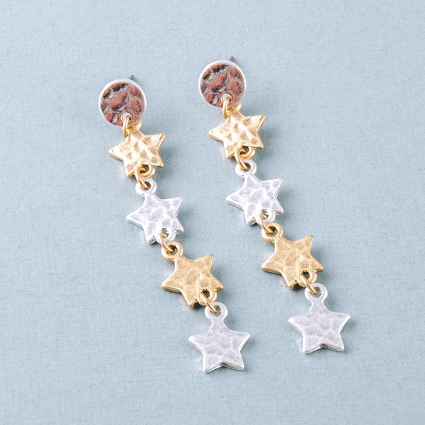 "Metal two tone star drop earrings. Approximately 2.5"" in length."