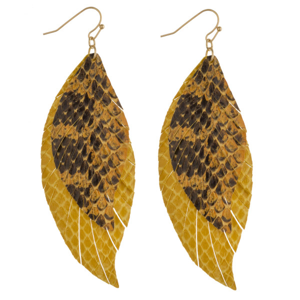 """Two tone double layered faux leather snakeskin feather earrings. Approximately 4"""" in length."""