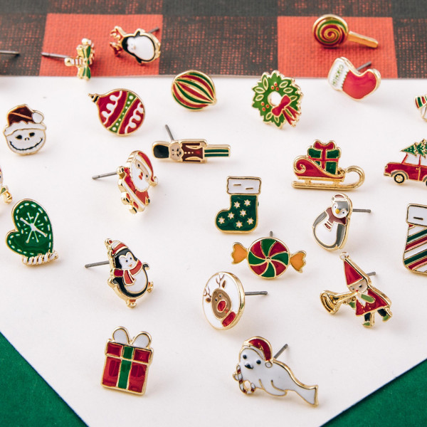 """Christmas stud earring set featuring three pairs with gift, snowman and volkswagen enamel details. Approximately .5"""" in size."""