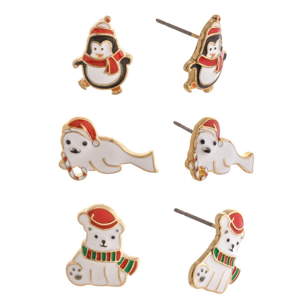 "Christmas stud earring set featuring three pairs with penguin, seal and polar bear enamel details. Approximately .5"" in size."