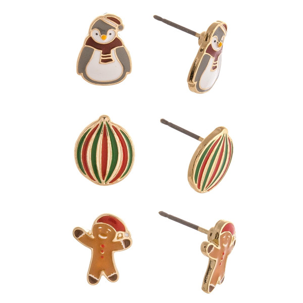 Christmas stud earring set featuring three pairs with penguin, ornament and gingerbread enamel details. Approximately 1cm in size.