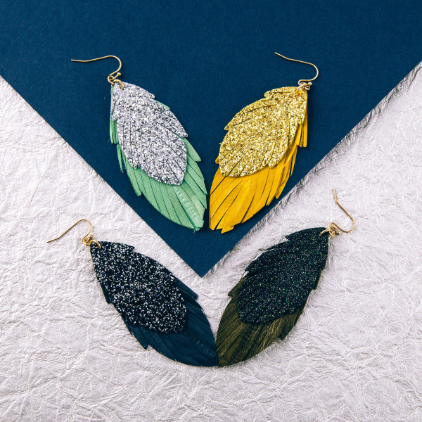 """Double layered genuine leather feather inspired earrings featuring glitter accents. Approximately 3"""" in length."""