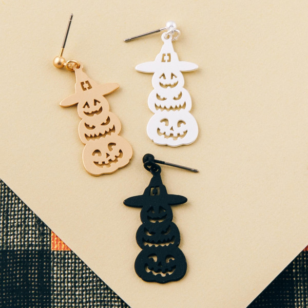 "Metal pumpkin halloween earrings. Approximately 1.5"" in length."