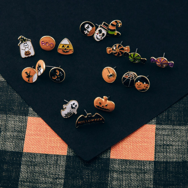 "Halloween stud earring set featuring three pairs with BOO, ghost and candy corn enamel details. Approximately .5"" in size."