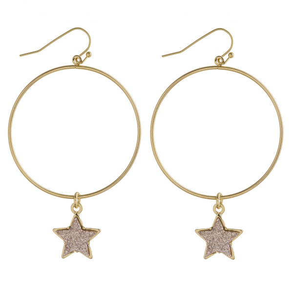 "Round metal earrings featuring a druzy star accent. Approximately 2.5"" in length."