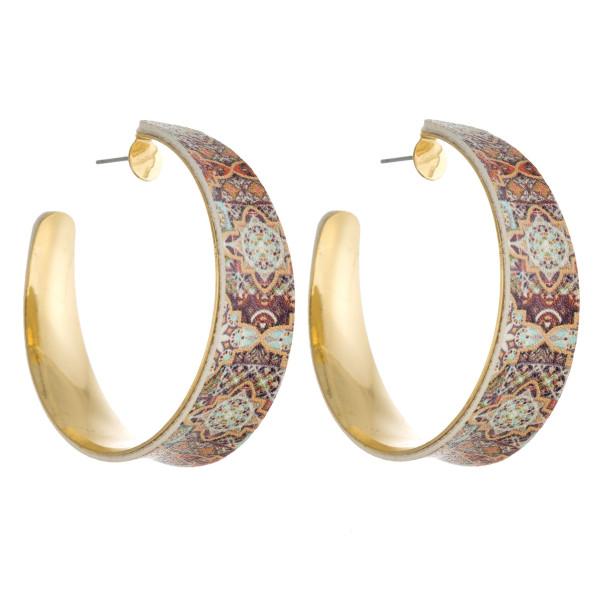 """Faux leather geometric open hoop earrings. Approximately 2"""" in diameter."""