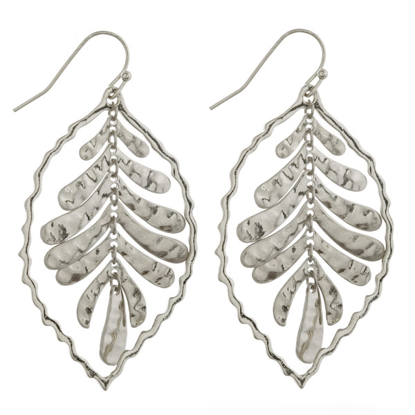 """Metal nested leaf earrings. Approximately 2"""" in length."""