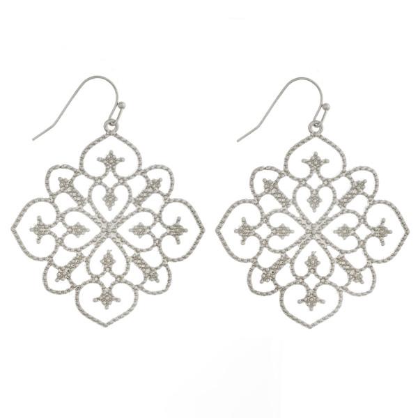 "Metal pattern inspired drop earrings. Approximately 2"" in length."