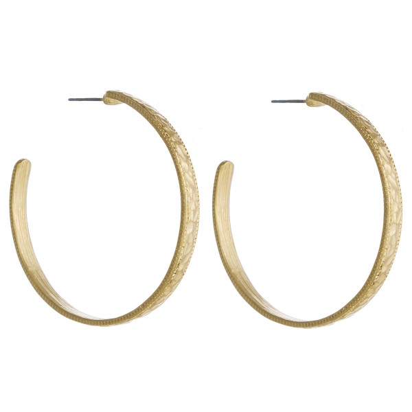"""Metal hoop earrings with hammered texturized details. Approximately 2"""" in diameter."""
