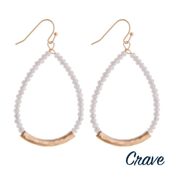 """Faceted beaded teardrop earrings with a gold accent. Approximately 2"""" in length."""