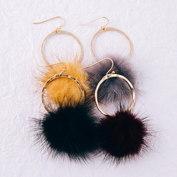 "Round metal earrings with faux fur accents. Approximately 2.5"" in length."