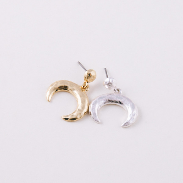 """Metal crescent stud earrings. Approximately .75"""" in length."""