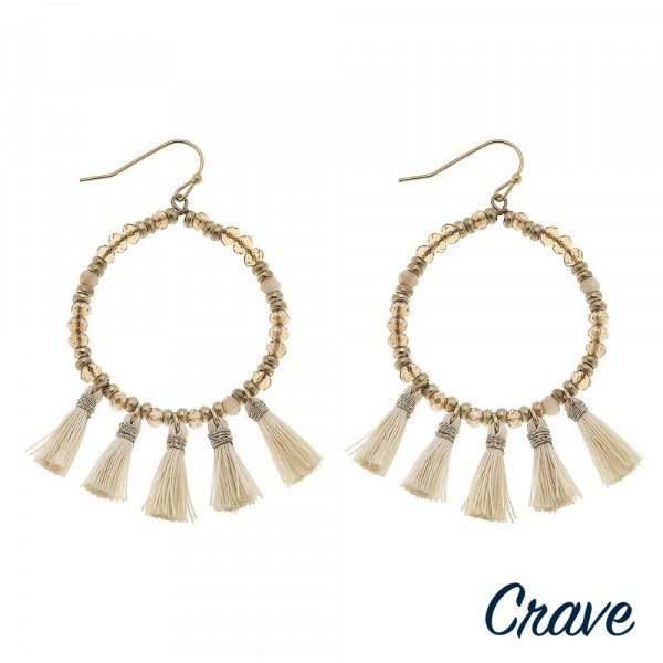 "Round beaded earrings featuring fan tassel details. Approximately 2.5"" in length."