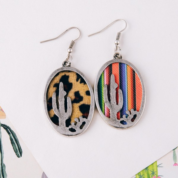 """Faux leather leopard print encased western cactus dangle earrings. Approximately 2"""" in length."""