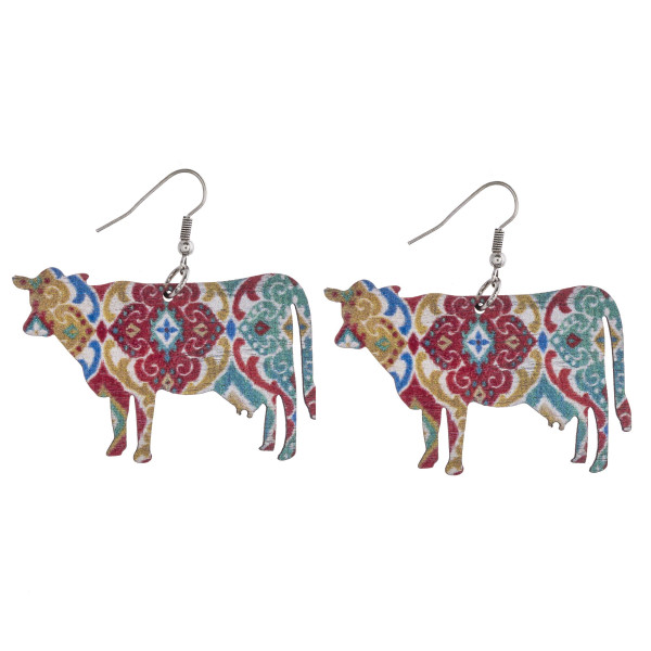 "Geometric cow laser cut wood earrings. Approximately 1.5"" in length."
