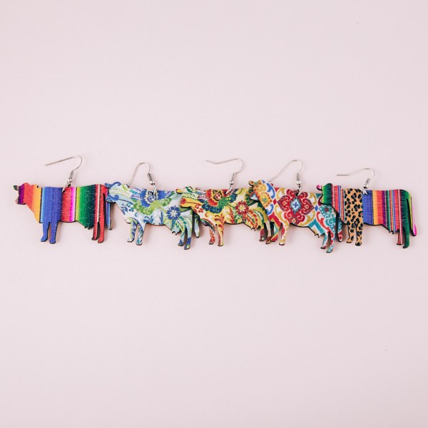 "Leopard print serape cow laser cut wood earrings. Approximately 1.5"" in length."