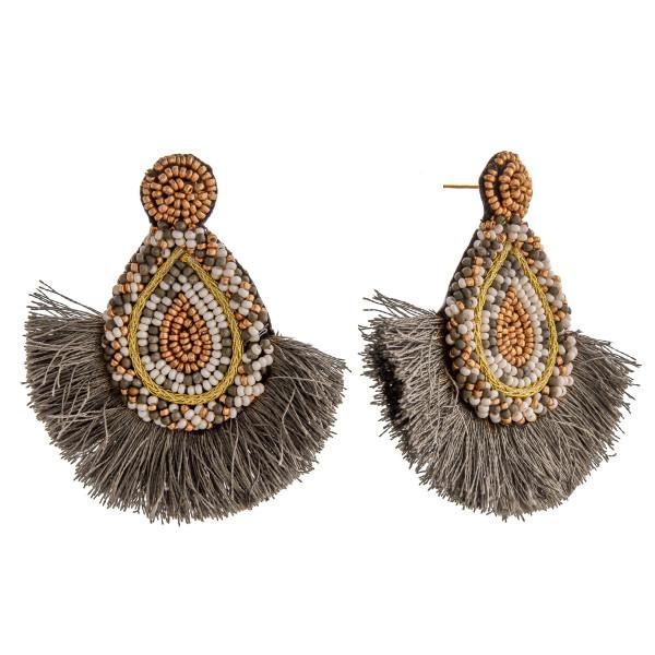 """Seed beaded felt teardrop tassel earrings. Approximately 2.5"""" in length."""