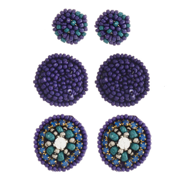 """Seed beaded felt disc earring set with cubic zirconia and rhinestone accents.  - 3 pairs - Smallest size: .5"""" in diameter - Largest size: 1"""" in diameter"""