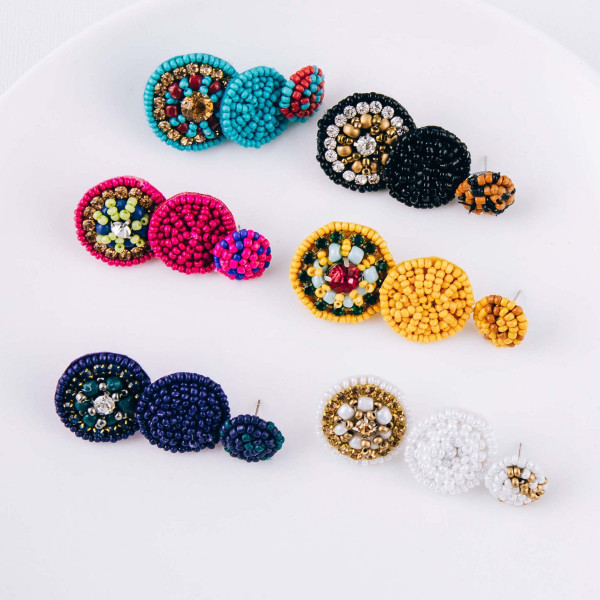 "Trio seed beaded felt disc earring set featuring rhinestone accents. Approximately .5"" in diameter - 1"" in diameter."