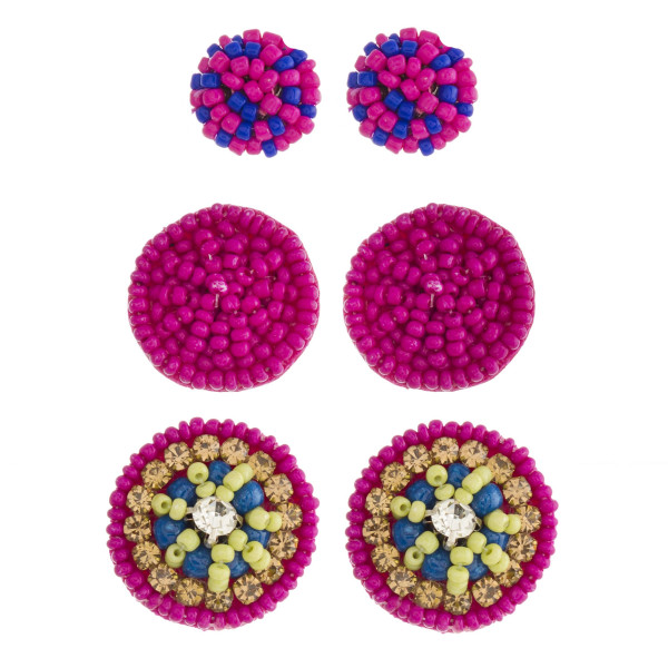 "Seed beaded felt disc earring set with cubic zirconia and rhinestone accents.  - 3 pairs - Smallest size: .5"" in diameter - Largest size: 1"" in diameter"